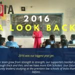 A photograph of a woman with a blackboard in the background. Students are sitting in front. Text of the photo saying 2016 A Look Back. Half of the IDIA logo is visible on top left corner. At the bottom it's written: 2016 was our biggest year yet. Our team grew from strength to strength, our supporters backed us