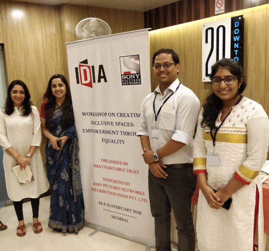 Four people are standing around a white standee with IDIA and Sony Pictures Networks logo on it. It says: Workshop of Creative Inclusive Spaces: Empowerment through Equality. Organised by IDIA Charitable Trust. Supported by Sony Pictures Networks Distribution India Limited