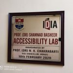Board with NUJS and IDIA logos. It says Prof. (Dr.) Shamand Basheer Accessibility Lab. Inaugrated by Prof. (Dr.) N.K. Chakrabarti. Vice Chancellor, WBNUJS. 10th February 2020.
