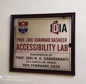 Board with NUJS and IDIA logos. It says Prof. (Dr.) Shamand Basheer Accessibility Lab. Inaugurated by Prof. (Dr.) N.K. Chakrabarti. Vice Chancellor, WBNUJS. 10th February 2020.