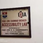 Board with NUJS and IDIA logos saying: Prof. (Dr.) Shamnad Basheer Accessibility Lab. Inaugurated by Prof. (Dr.) N.K. Chakrabarti. Vice Chancellor, WBNUJS. 10th February 2020.