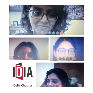 "Four screenshots of people talking over a video chat. IDIA Logo. Text saying ""Delhi Chapter"" below the logo."